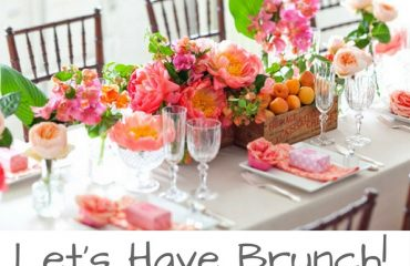 Urbabnella-City-Guide-Pretty-Table-Set-for-Brunch-Pink-Flowers-Oranges-White-Table-Cloth
