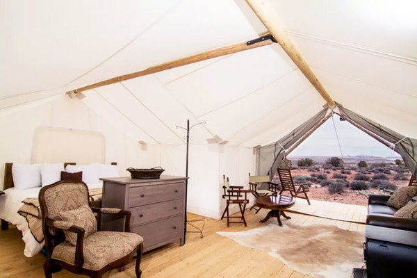 glamping-luxury-tent-moab-utah-king-bed-luxury chair-cream-design