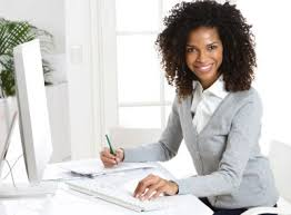 Black-Woman-Grey-Sweater-Sitting-at-computer-smiling-natural-hair